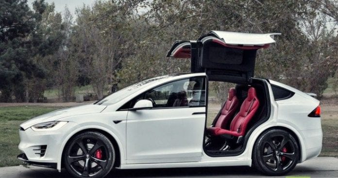 Awesome custom made Tesla Model X with Bentley red interior is ...