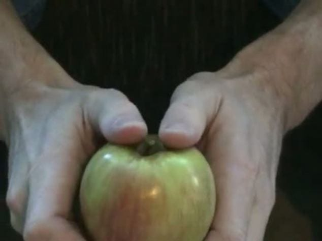 Learn to break an apple in half with your bare hands