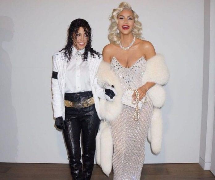 Kim and Kourtney Kardashian dress as music icons Madonna and Michael Jackson