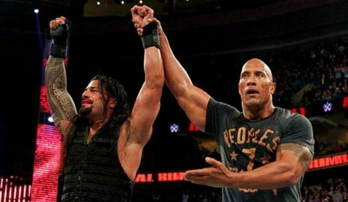 Roman Reigns The Rock 696x403