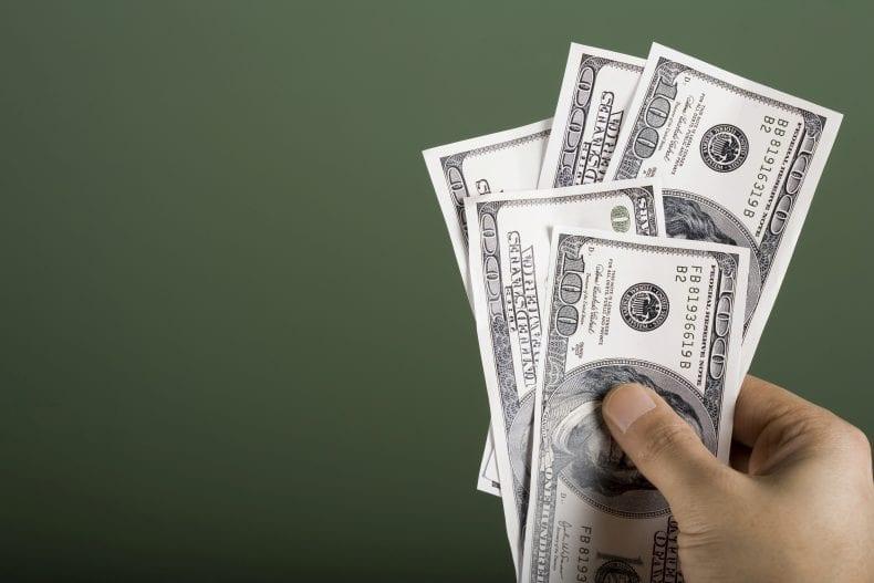 Hand Holding Money 790x527