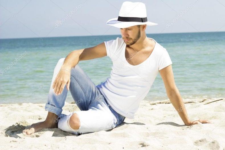 man on beach 790x527
