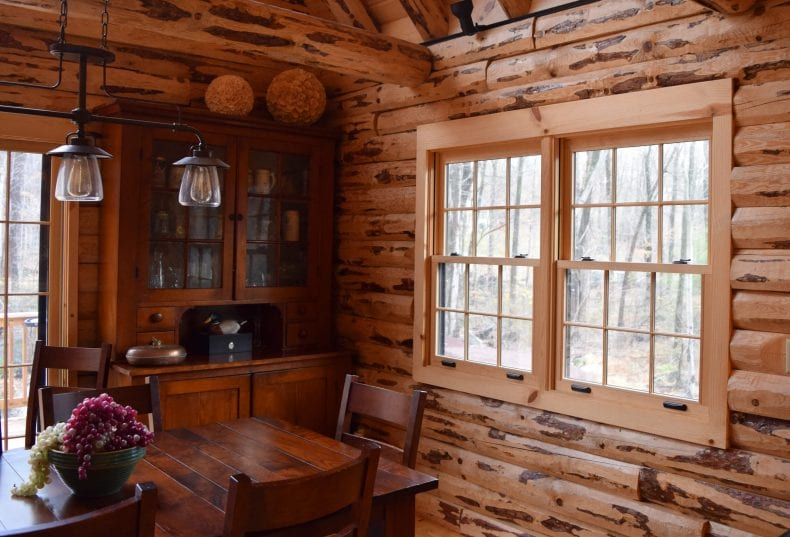 windows on wooden cabin 790x537