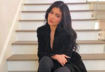 Kylie Jenner sitting on the stairs